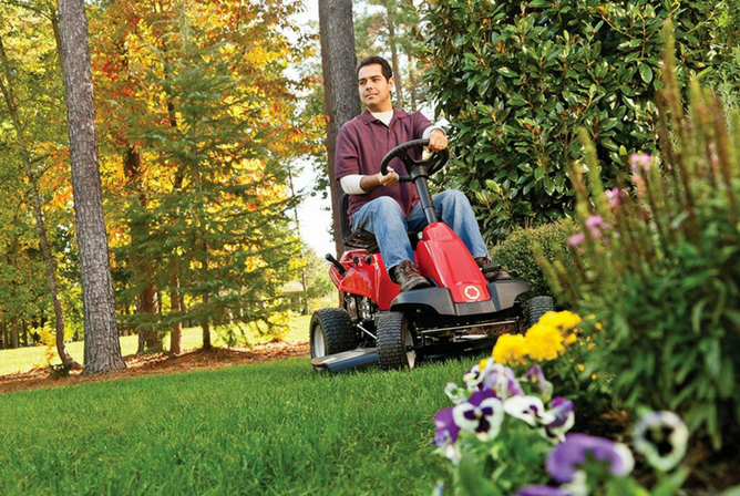 Troy-Bilt 30-Inch Neighborhood Riding Lawn Mower in use