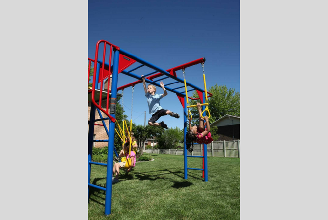 Lifetime Monkey Bar Adventure Swing Set with 9 Foot Wavy Slide monkey bars