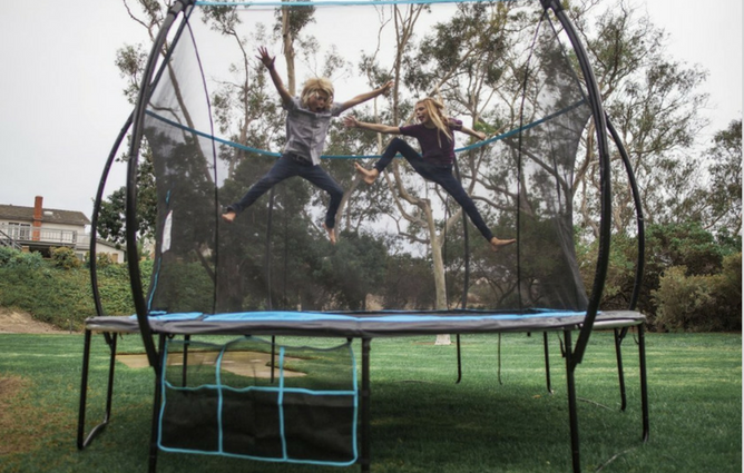 SkyBound Cirrus 14 ft Trampoline with Full Enclosure Net System in use