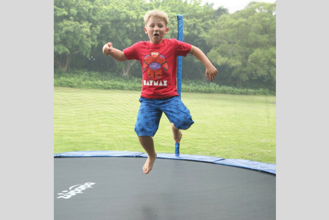 Zupapa TUV Approved Trampoline with Enclosure Net and Poles plus Safety Pad Ladder Jumping Mat and Rain Cover in use